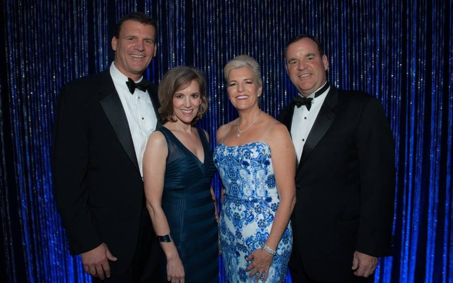 Two men and two women attend the 45th Annual Scripps Mercy Ball that raised $465,000.