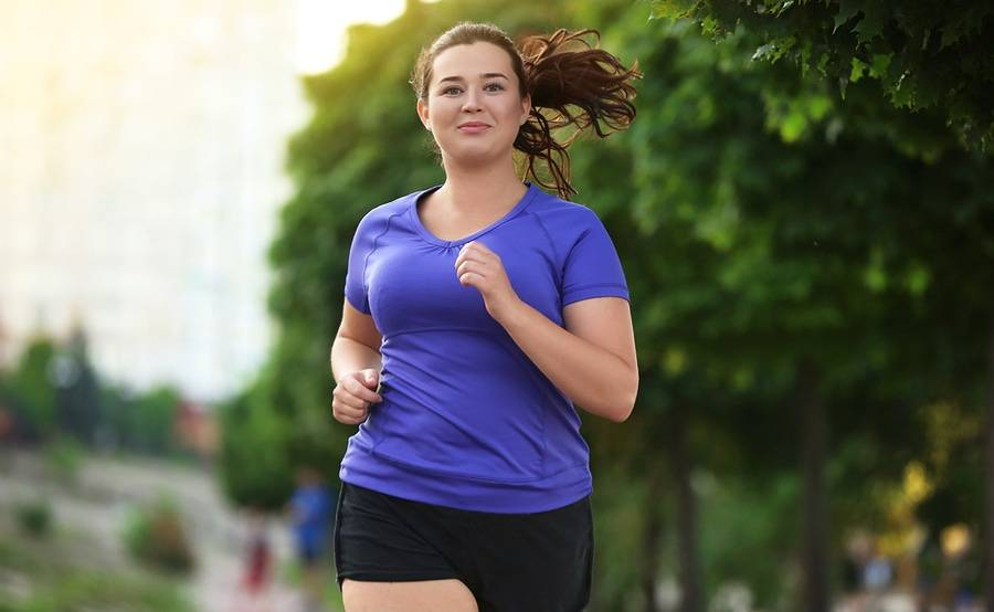 Young smiling woman out for a run