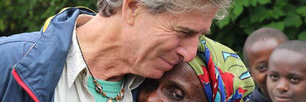 Scripps heart patient Bill Toone embraces a friend in Africa.
