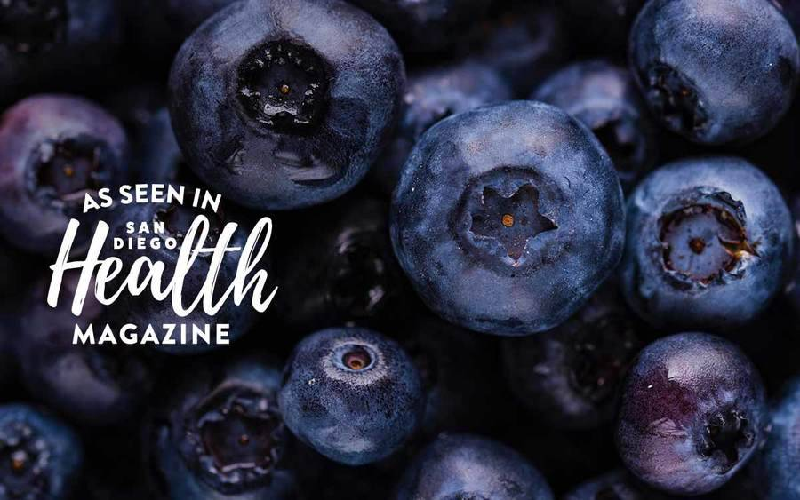 A group of fresh blueberries represents the types of superfoods you can plant in your garden.