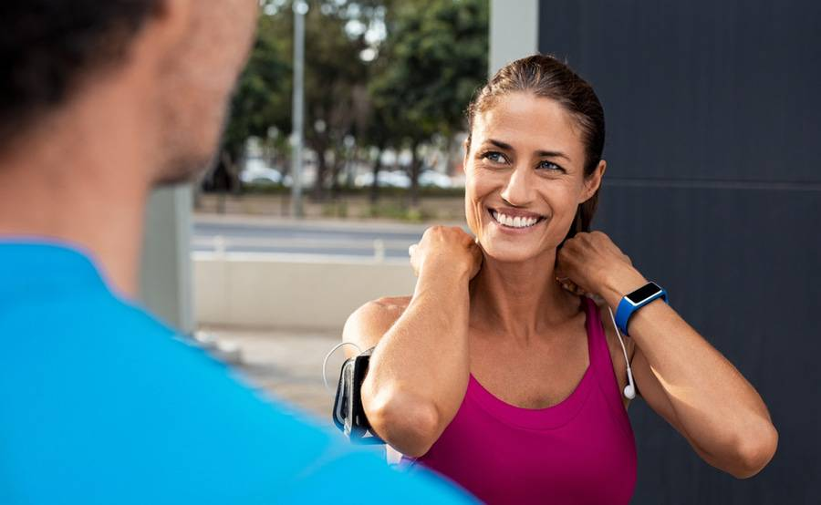 A middle-aged woman wearing a fitness tracker and workout clothes represents people treated for cardiomyopathy at Scripps.