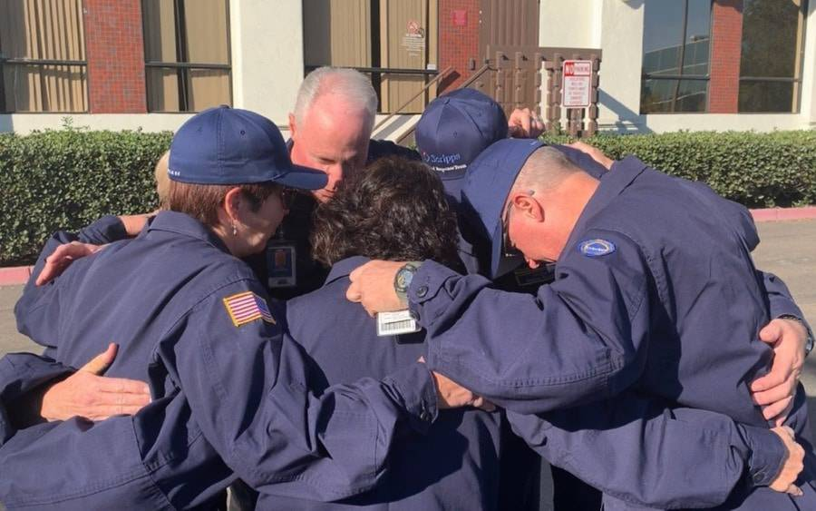 Members of Scripps Medical Response Team huddle before deployment to Northern California.