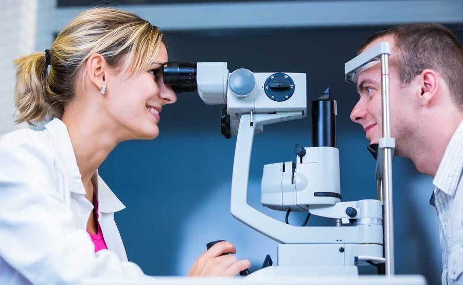 Scripps eye expert checks the vision for a patient interested in conductive keratoplasty.