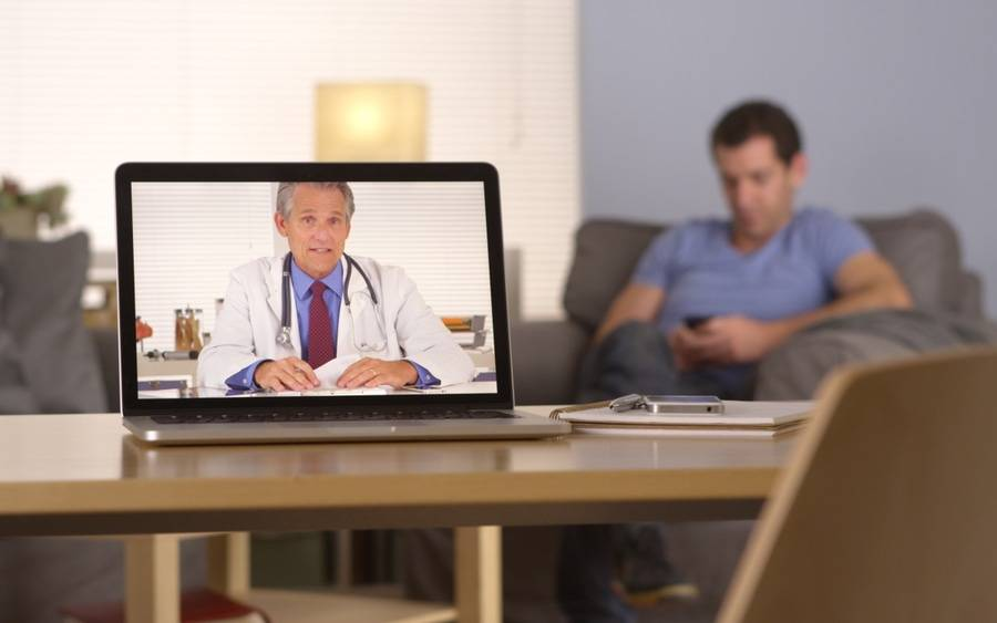 Diabetes patient texting and communicating with physician via webcam.