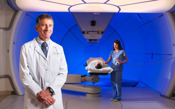 Dr Carl Rossi in Scripps Proton Therapy Room