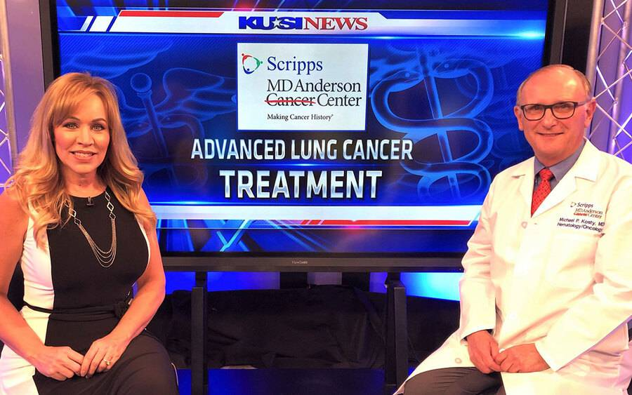 KUSI-TV anchor Ginger Jeffries sits with Dr. Michael P. Kosty of  Scripps MD Anderson Cancer Center in a TV studio.