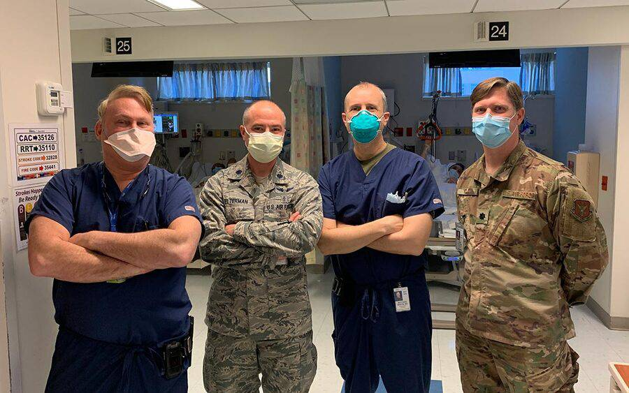 Scripps trauma surgeon Dr. Matthew Martin stands with a medical team at  Jacobi Medical Center during COVID-19.