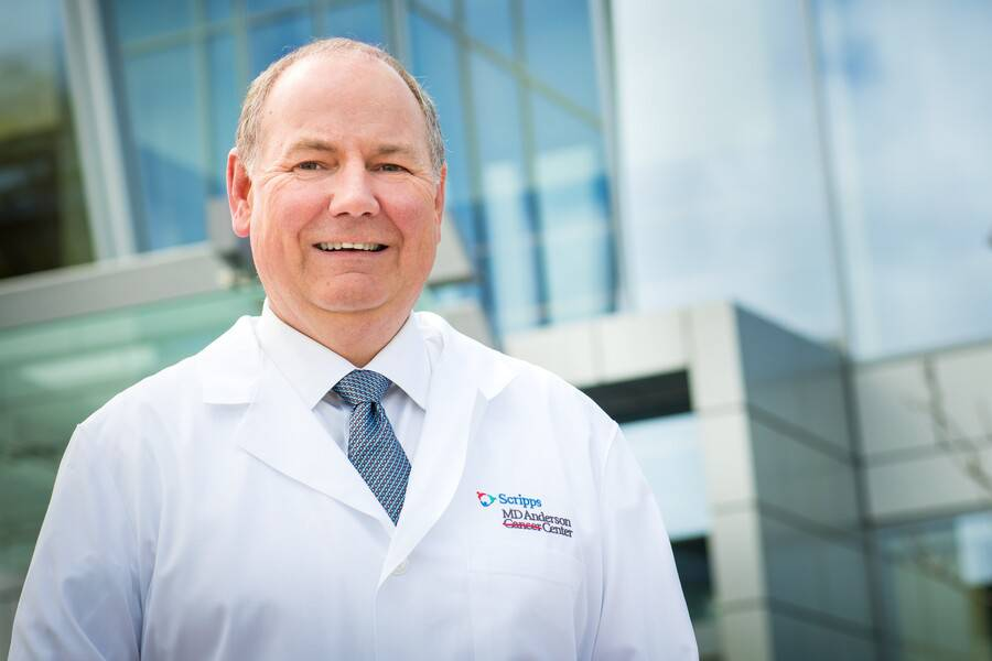 Thomas Buchholz, MD, stands in front of the Scripps MD Anderson Center in San Diego.