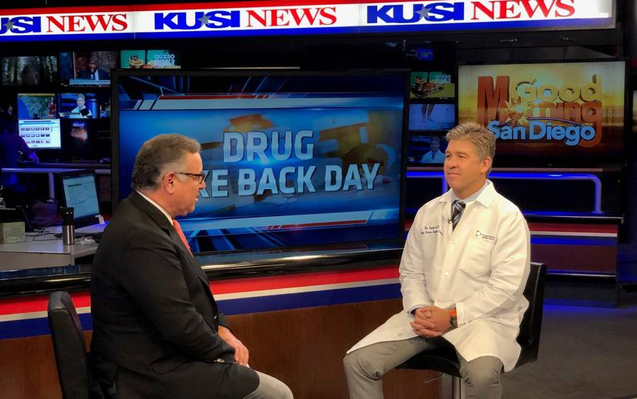Ole Snyder, MD, physician chair of Scripps Opioid Stewardship Program, and Carlos Amezcua, KUSI anchor.