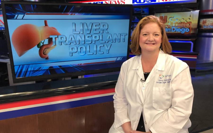 A Scripps doctor prepares to discuss a new liver transplant policy on the news.
