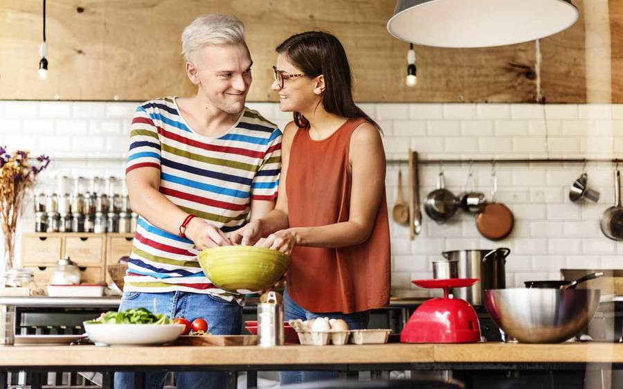 A couple makes a healthy dinner in their pleasant kitchen