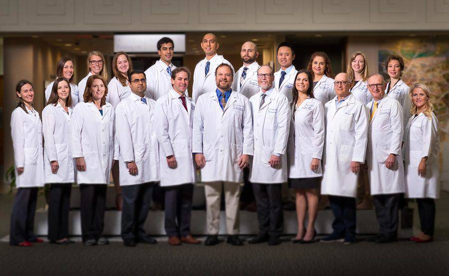 Standing in two rows and wearing white lab coats, the faculty and fellows of the Hematology and Medical Oncology Fellowship Program at Scripps Clinic are shaping the future of cancer treatment.