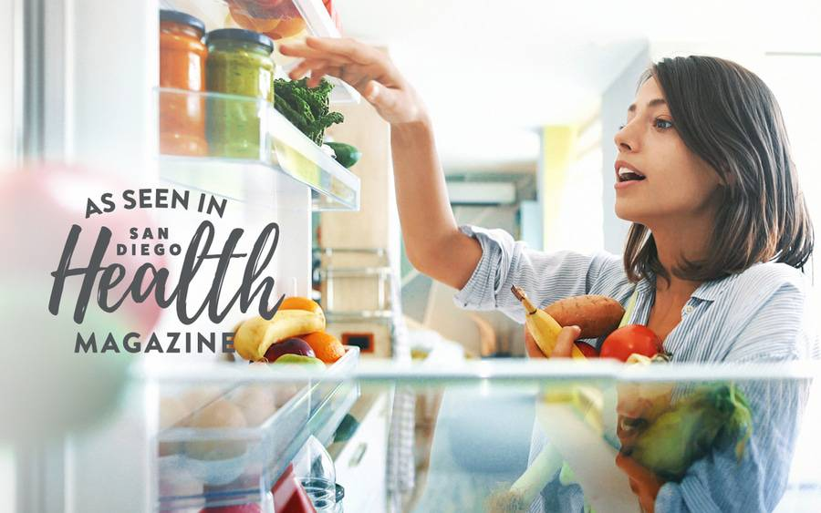 A woman pulling fruits and vegetables from her refrigerator is getting ready to make a healthy meal that fits her nutrition and weight management goals.