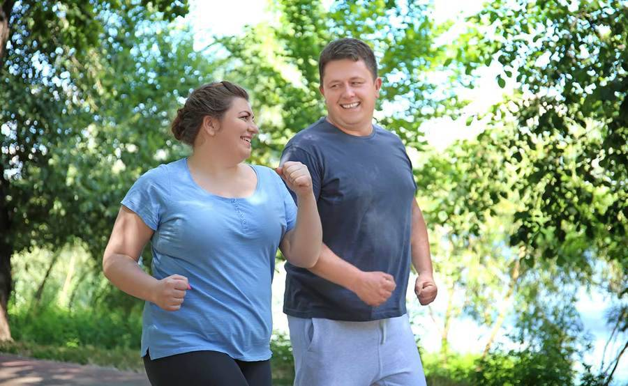 A couple walking outdoors for exercise, representing the active lifestyle people often enjoy after gastric banding surgery.