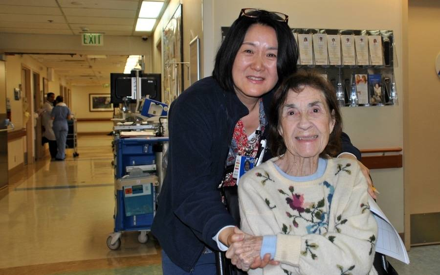 Scripps Encinitas nurse, Grace Cao, embraces a Scripps patient, and ultimately netted a CARE award by CBS Radio.