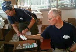 Haiti - CVG and McQuillen pack supplies