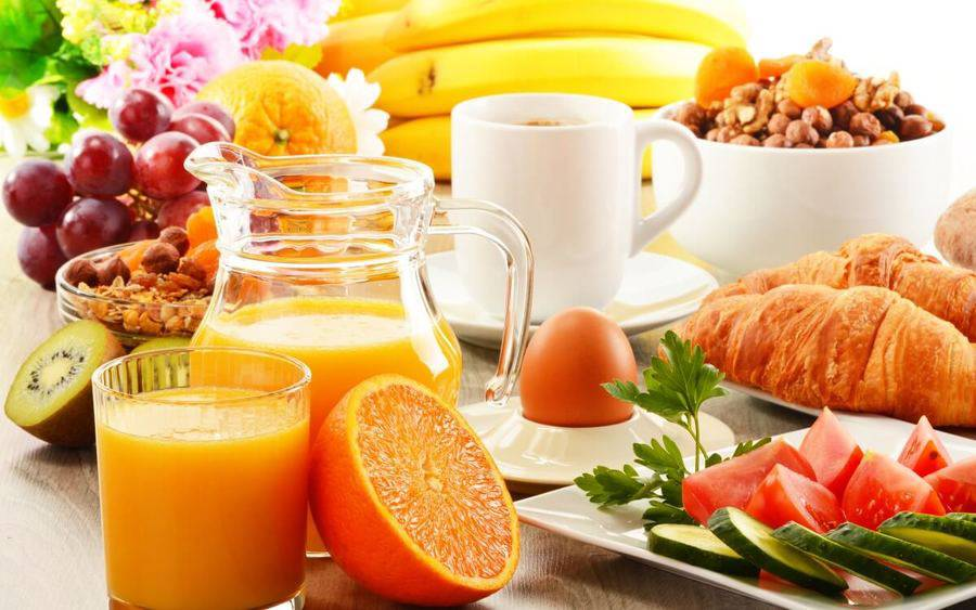 Eat this, not that for Breakfast picture, including orange juice, cereal and croissants.