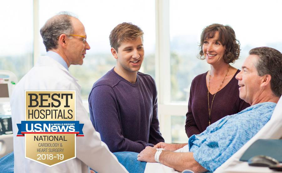 Cardiologist Martin Charlat, MD, discusses heart care with a patient and his family members.
