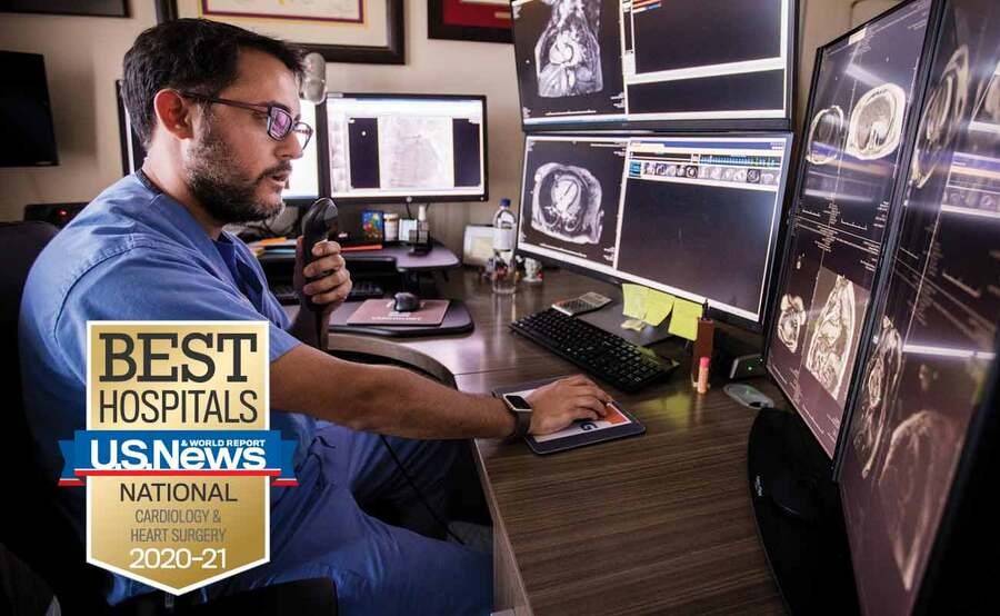 Scripps Clinic cardiologist Jorge Gonzalez, MD, reviews the results of a patient's imaging tests.