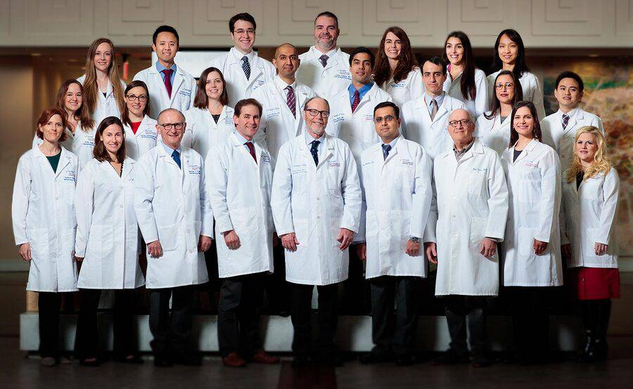 Standing in three rows and wearing white lab coats, the faculty and fellows of the Hematology and Medical Oncology Fellowship Program at Scripps Clinic are shaping the future of cancer treatment.