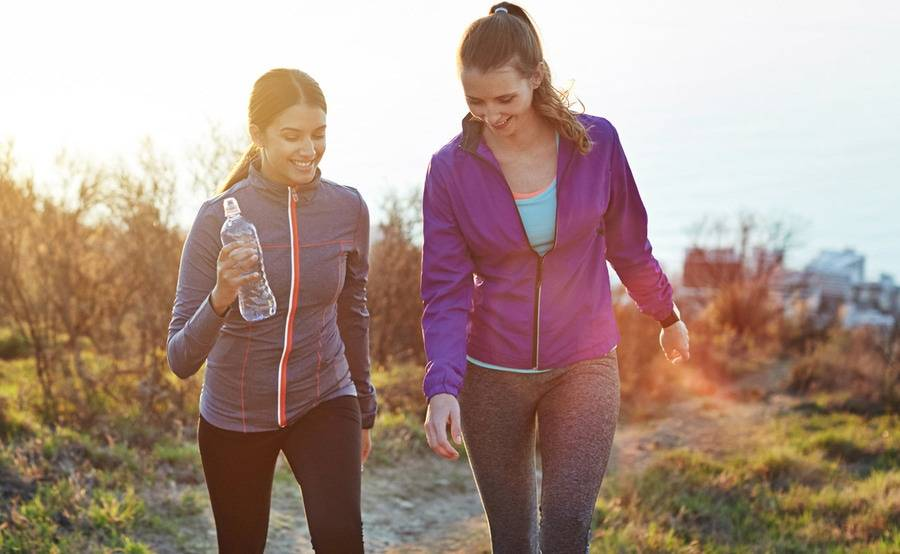 Two women enjoy an outdoor hike, representing the range of birth control and family planning options available at Scripps.