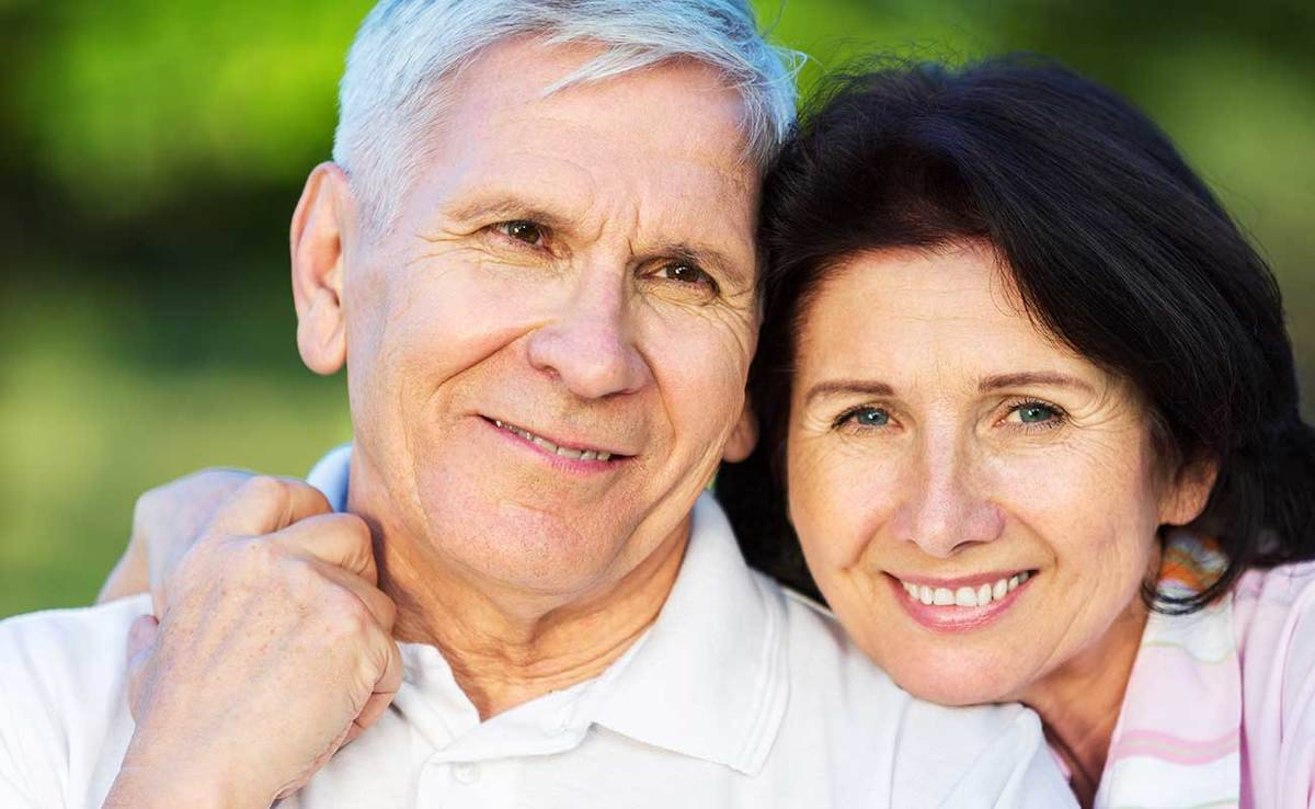 A smiling mature couple represents the full life that can be led after esophageal cancer treatment.