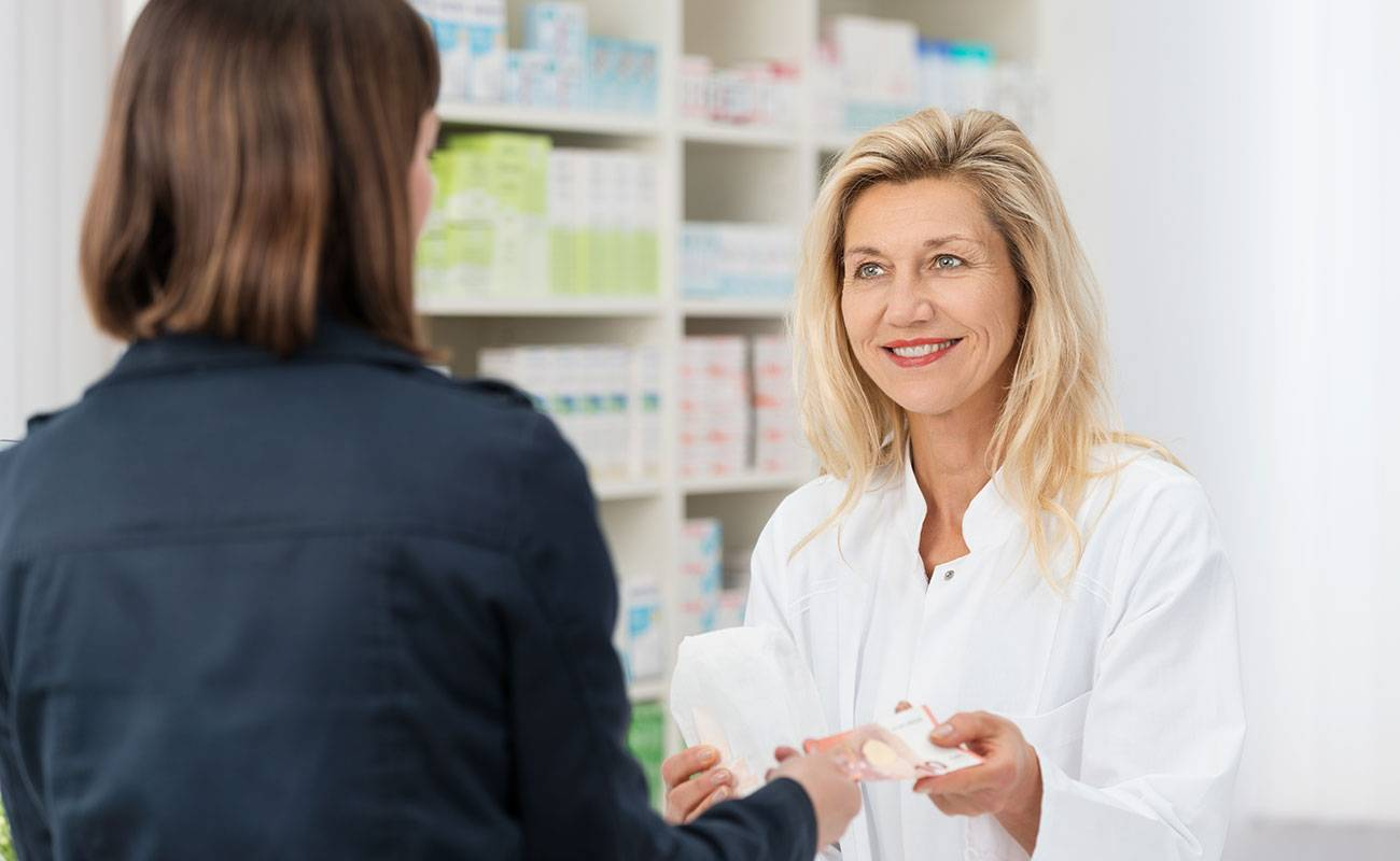 Pharmacist consulting patient about medication