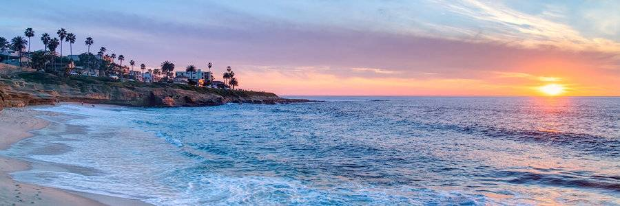 A sunset view of La Jolla shores represents one of the beautiful locations offering hotel and lodging discounts for out-of-town patients.