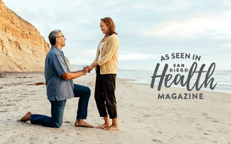 A man and his wife hold hands on a beach while celebrating five years of good health after a living donor kidney transplant at Scripps Center for Organ and Cell Transplantation.