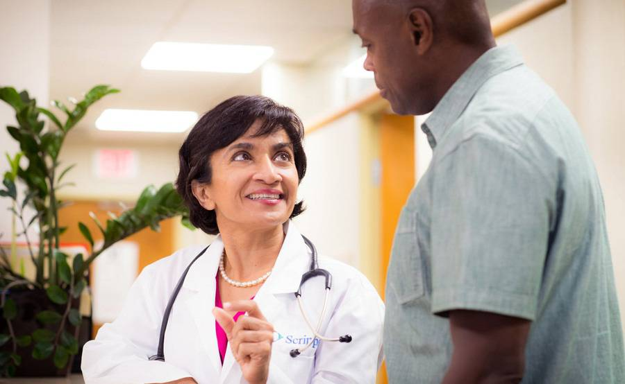 Dolly Doctor, MD, internal medicine physician at Scripps Coastal Medical Center in Encinitas talks with a patient.