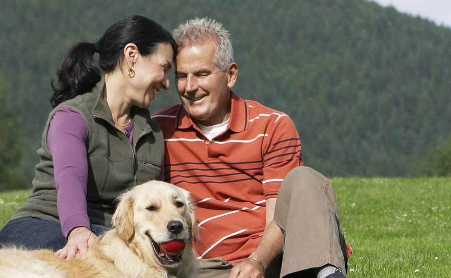 A smiling middle-aged couple represents the full life that can be led after intestinal cancer treatment.
