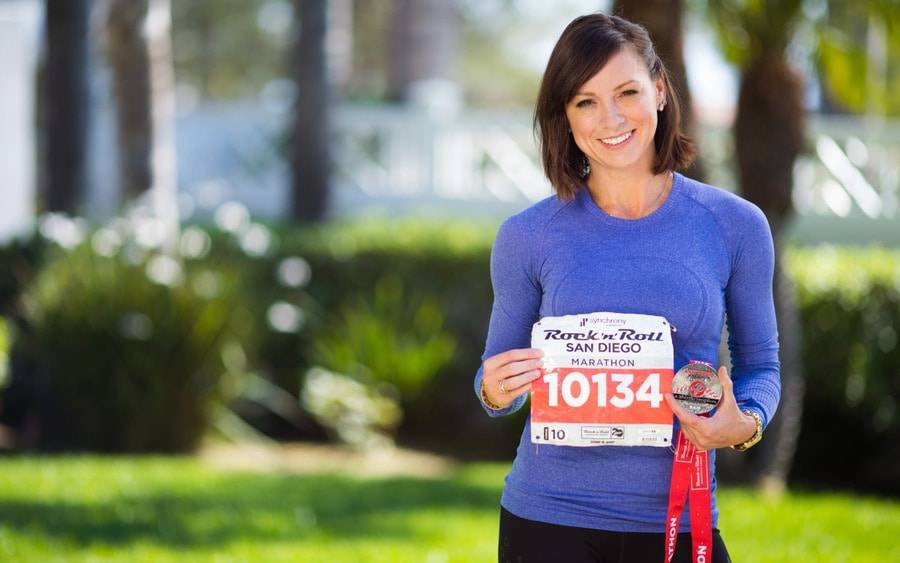 Kristy Castillo, who has type 1 diabetes, poses after completing San Diego marathon.