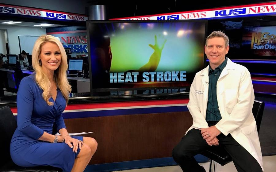 Dr. Mark Shalauta and KUSI anchor Lauren Phinney at KUSI studio discussing heat stroke.