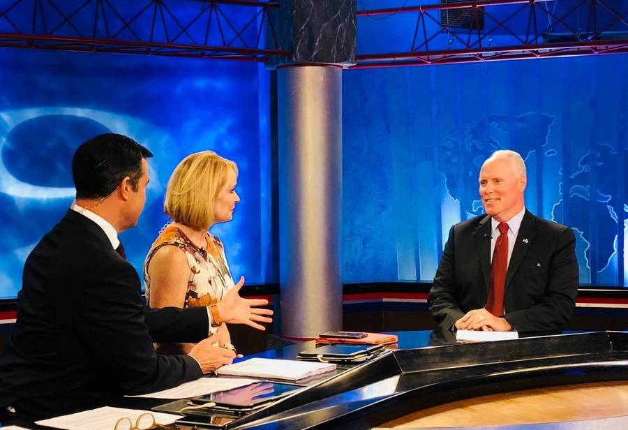 Scripps CEO, Chris Van Gorder, talks to KUSI news anchors in an interview.