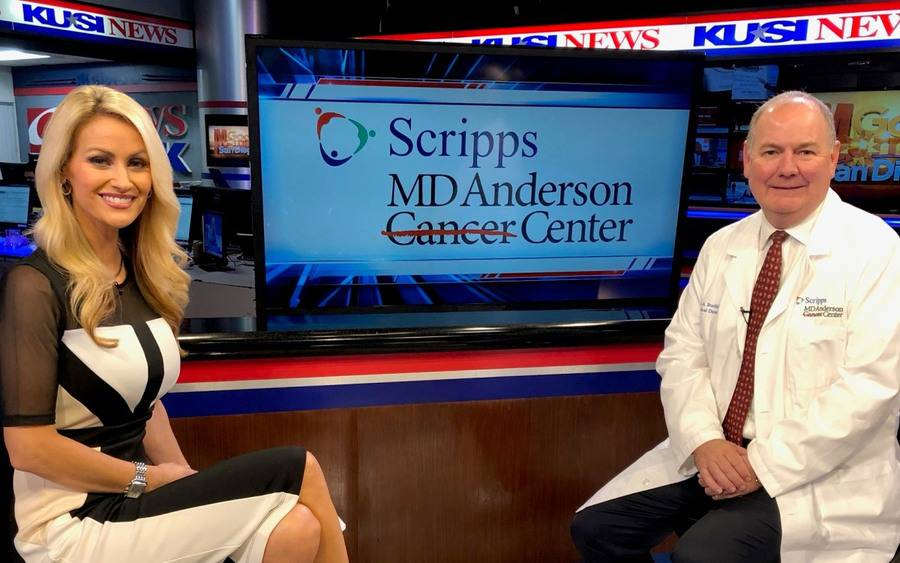 KUSI anchor Lauren Phinney on set with Dr. Thomas Buchholz,  medical director of Scripps MD Anderson Cancer Center.
