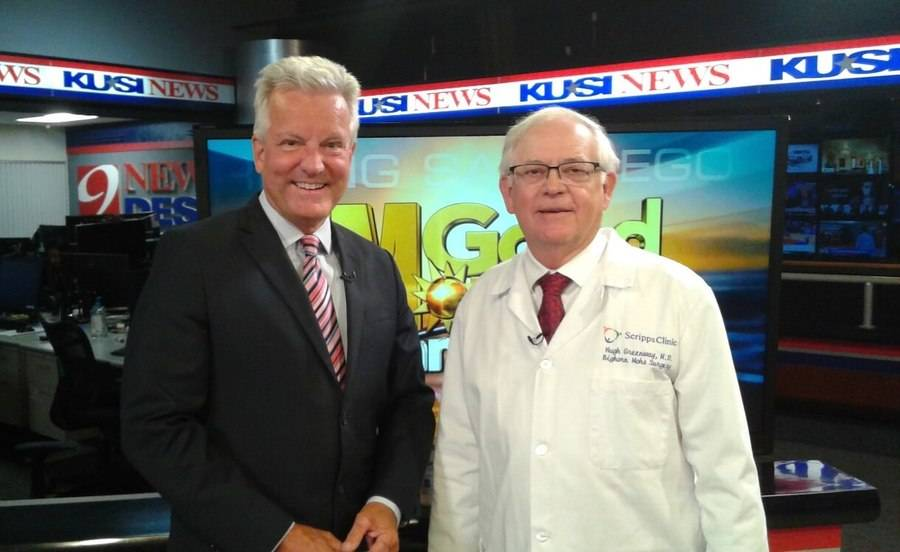 Hubert Greenway, MD, stands with a San Diego news anchor during his segment about skin cancer and prevention awareness.