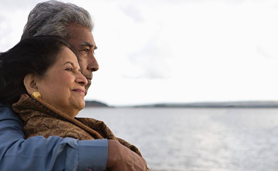 A smiling Hispanic couple represents the full life that can be led after liver cancer treatment.