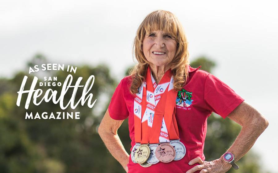 66-year-old competitive runner Sue Rudolph proudly wears the seven gold, silver and bronze medals she won soon after receiving a liver transplant.