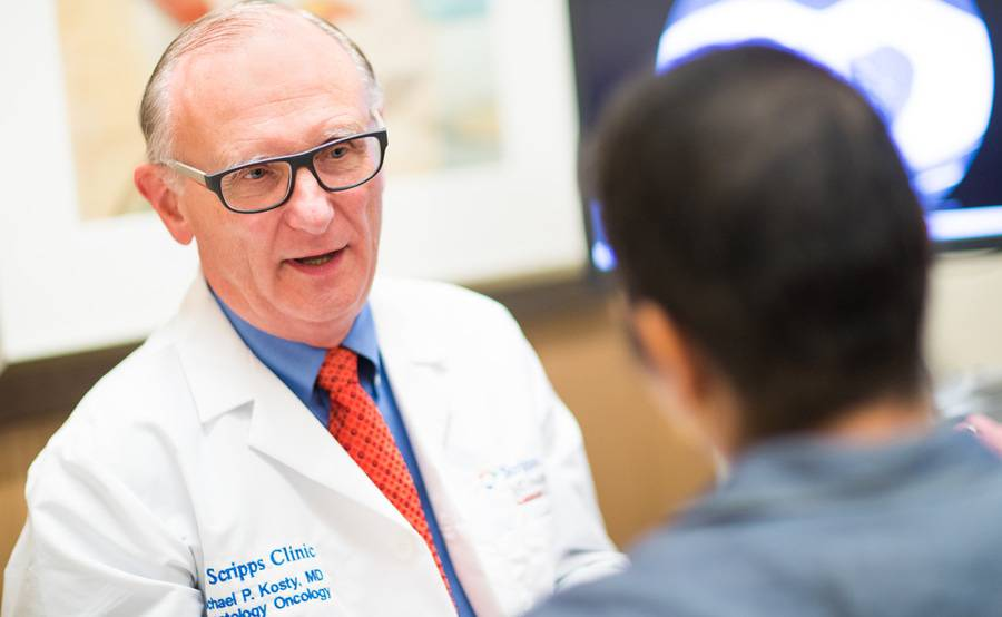 Oncologist and lung cancer expert Dr. Michael Kosty talks with a patient at Scripps in San Diego.