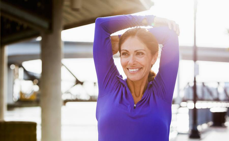 Happy woman, represents a woman that is aware of menopause symptoms and changes due to great obgyn care at Scripps Health.