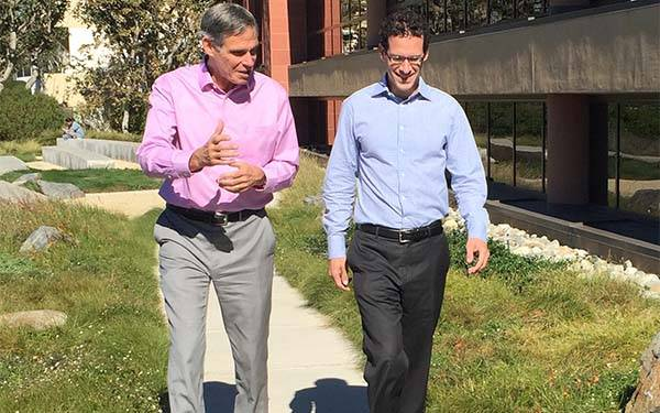 DePodesta and Dr. Topol walking on a sunny day.