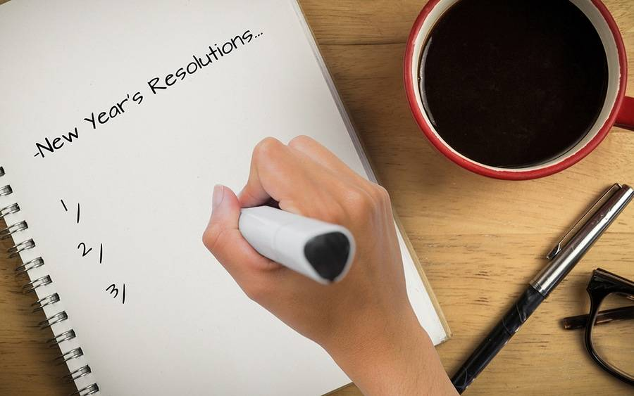 Woman writing New Year's resolution