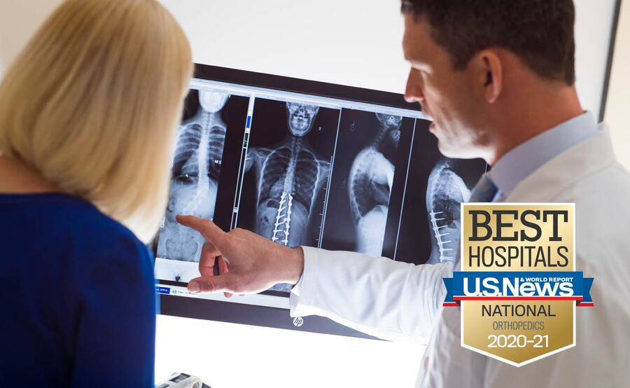 Scripps spine specialist Gregory Mundis, MD, reviews an X-ray of the spine with a patient.