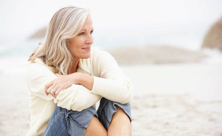A smiling mature woman represents the full life that can be led after ovarian cancer treatment.