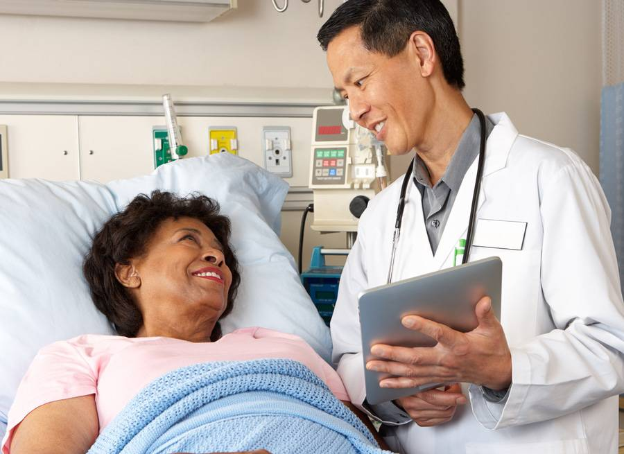 Patient with special needs using tablet to communicate with doctor.