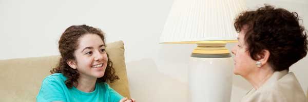 Scripps pediatric speech therapist provides consultation and treatment for an adolescent girl in a clinical setting.