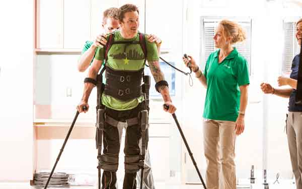 A wearable robot called Ekso benefits patients with paralysis.