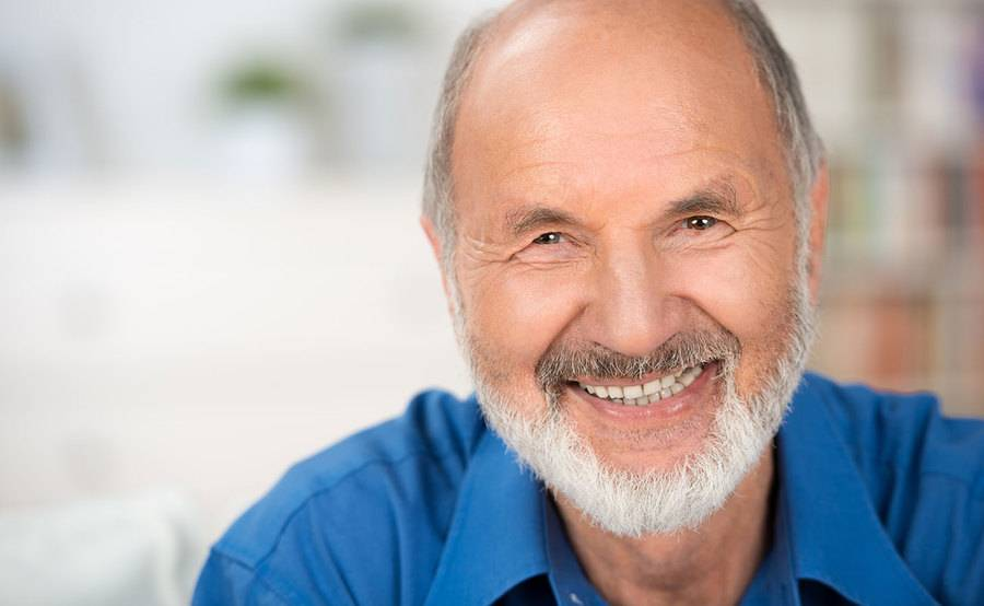 A smiling mature man represents the full life that can be led after prostate cancer treatment.