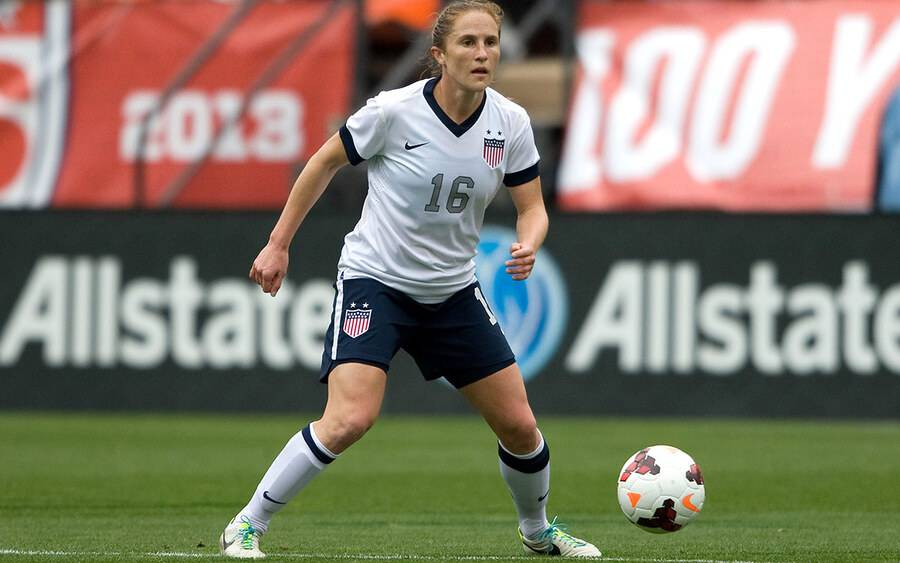 Rachel Buehler Van Hollebeke, MD playing soccer for the US Women's National Soccer team.