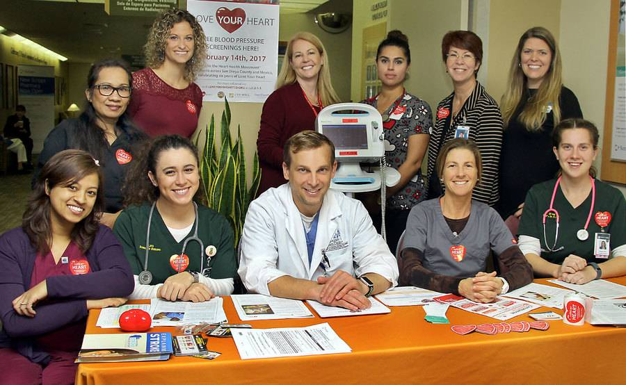 Scripps employees pose for a photo at the Love Your Heart Blood Pressure Screening. The organization joined the joined the County of San Diego for the sixth annual event. It's one of the many community health services at Scripps.